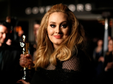 Singer Adele, winner of the Oscar for best original song, is interviewed at the Governors Ball for the 85th Academy Awards in Hollywood